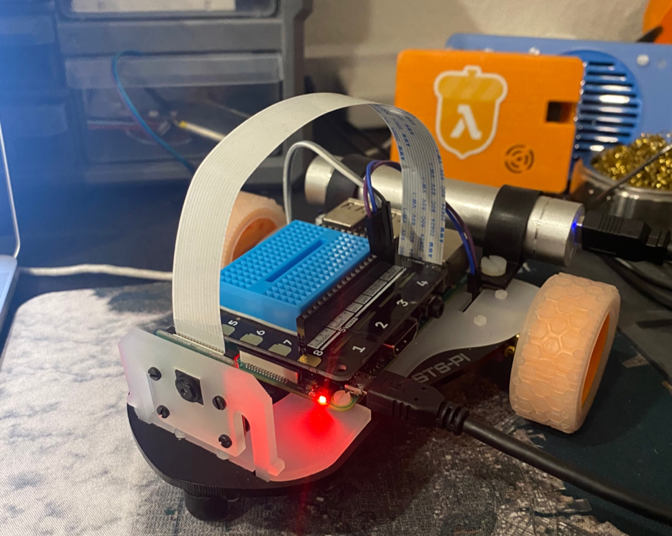 A Pimoroni STS-Pi Robot Kit connected to AWS for remote control and viewing.