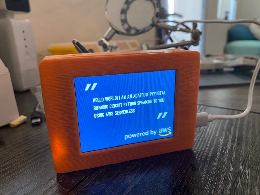 An Adafruit PyPortal displaying a quote while synthesizing and playing speech using Amazon Polly.