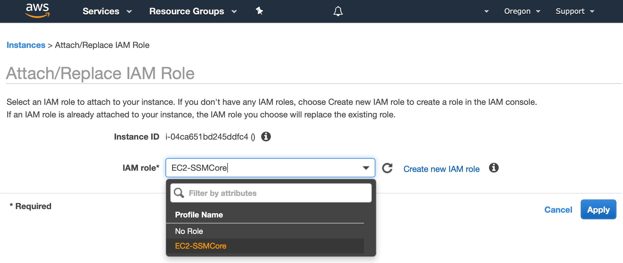 AWS Management Console shows the dialog to Attach/Replace IAM Role. The EC2-SSMCore role that was created in the last section is selected from a drop down box.