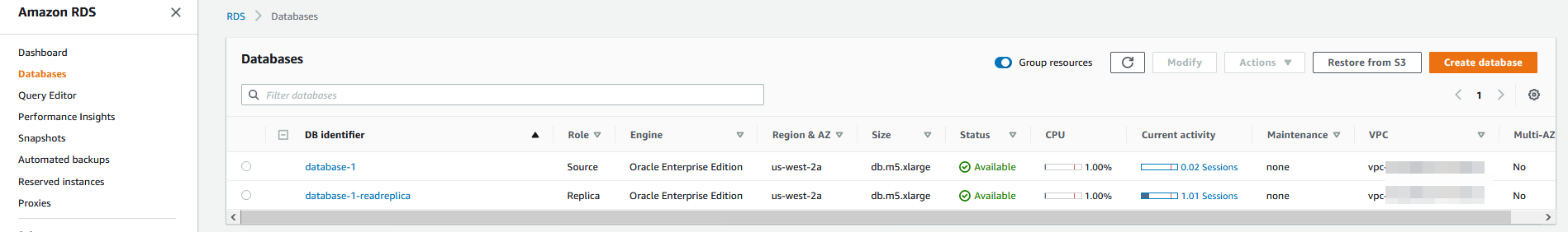 The Databases page displays a source database (database-1) and replica (database-1-readreplica).