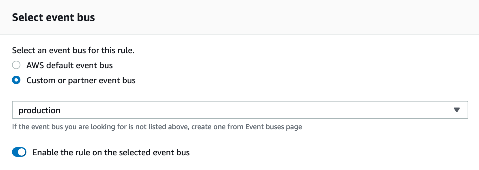 In Select event bus, the Custom or partner event bus option is selected. Production is selected from the dropdown. The Enable the rule on the selected event bus option is selected.