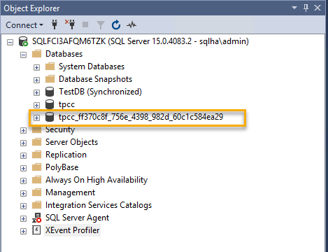 In Object Explorer, a temporary GUID is appended to the restored database.