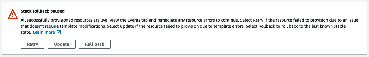The Stack rollback paused message says that all successfully provisioned resources are live. The console displays Retry, Update, and Roll back buttons.