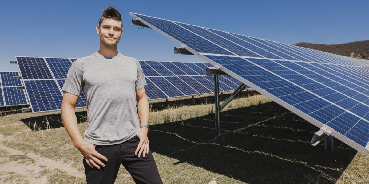 Dr. Nick Engerer, CTO of Solcast, standing next to solar panels