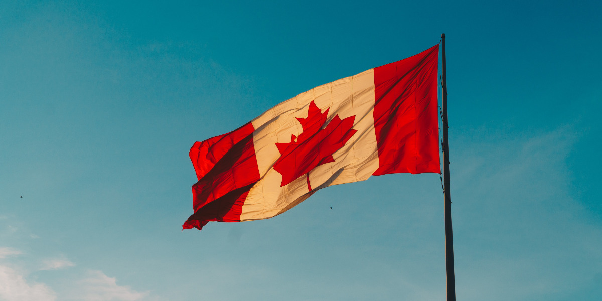 Canada flag outside waving in wind
