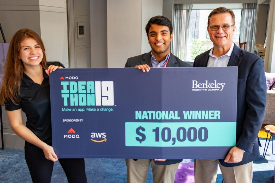 Modo Labs Ideathon winners with check