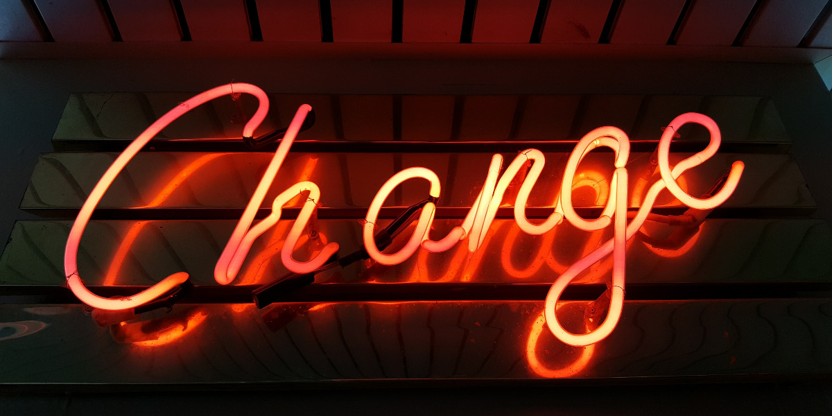 "Neon sign text ""Change""; Photo by Ross Findon on Unsplash"