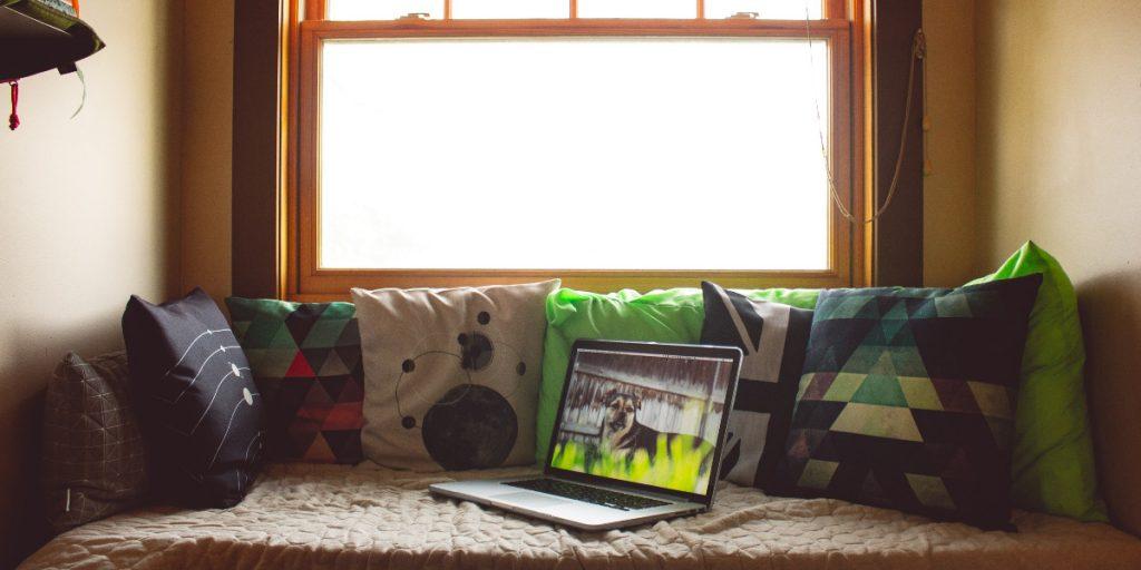 open laptop by a window