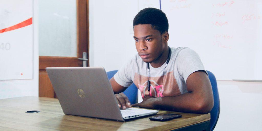 Virtual exchange, student at laptop