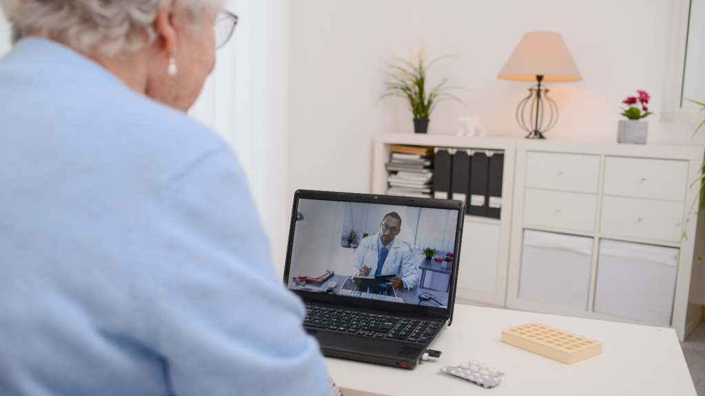 older woman on a laptop during a telemedicine consultation with a doctor