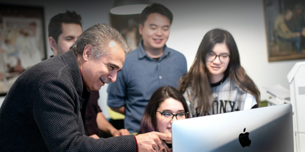 CyberPatient's founder, Dr. Qayumi, teaches students on computer