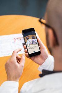 man on healthcare app on iphone