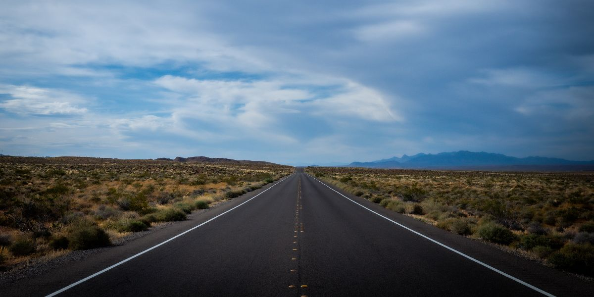 open road leading to horizon