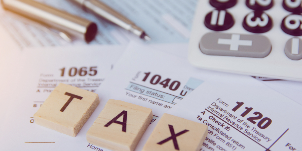 tax forms with calculator on table top