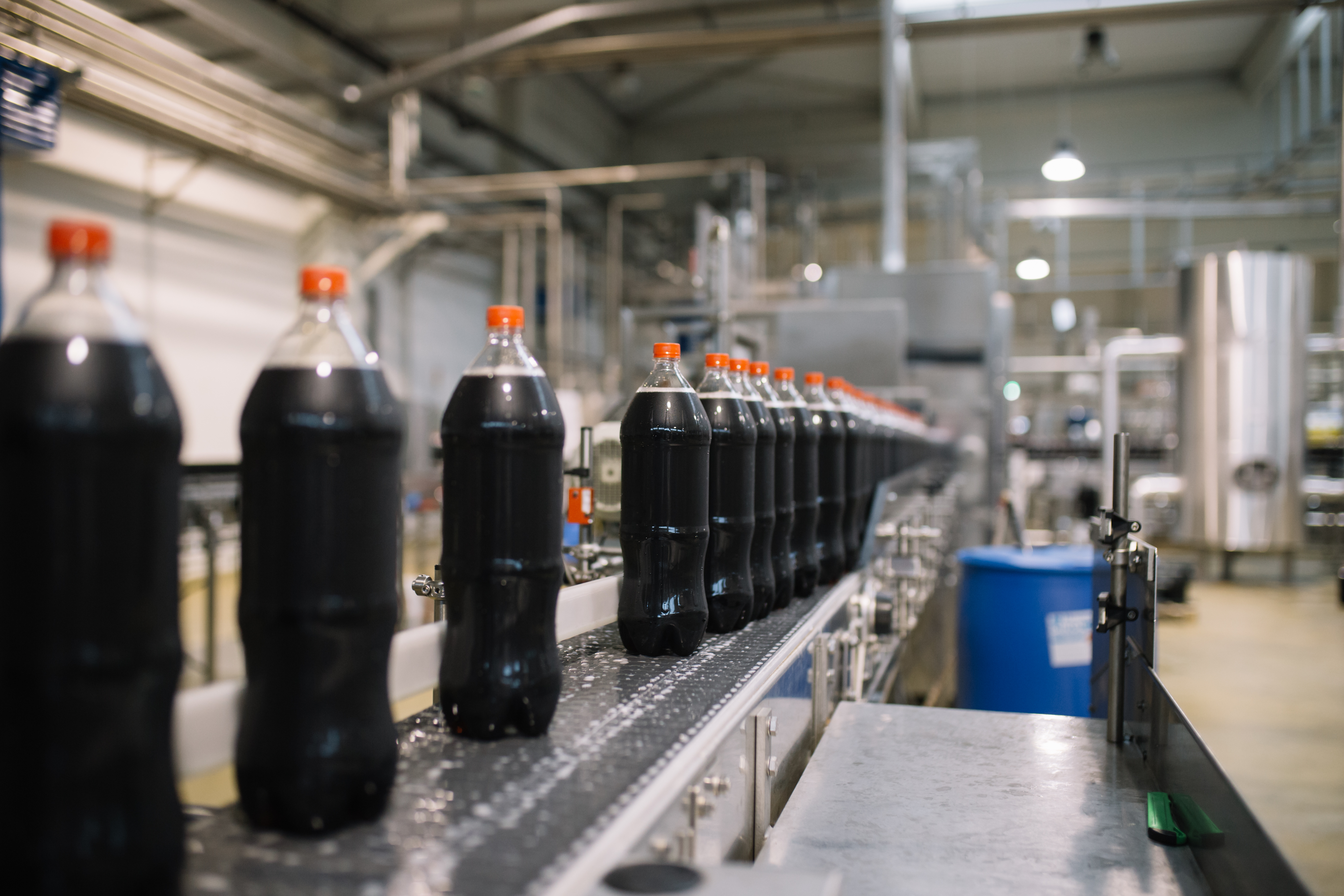 Bottling factory - Coke bottling line for processing and bottling juice into bottles. Selective focus.