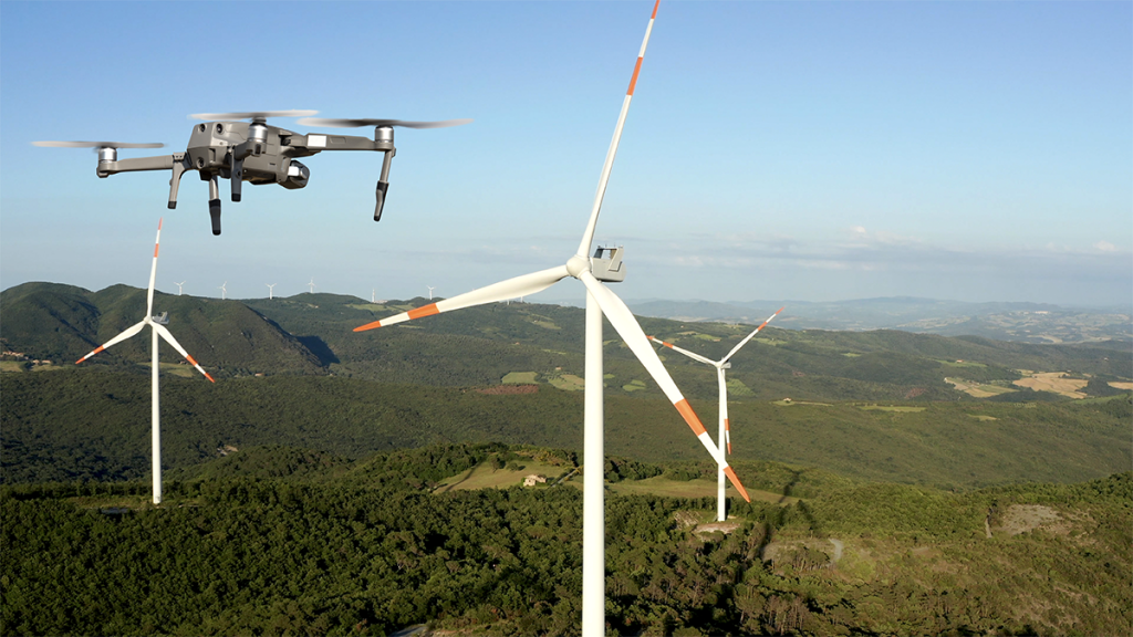 drone flying in front of the turbines