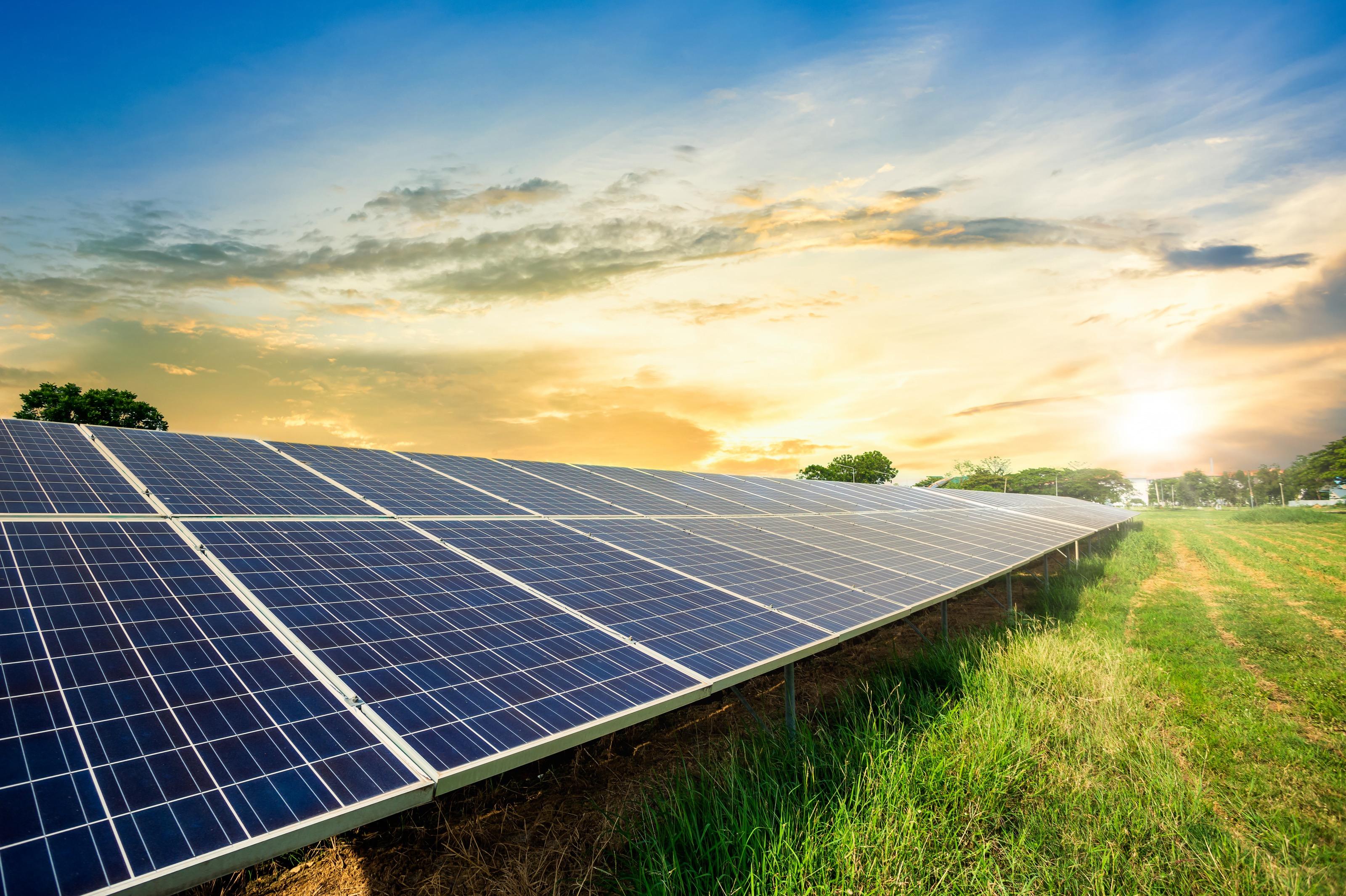 vecteezy_solar-panel-cell-on-sunset-sky-background-clean-alternative-power-energy-concept_1235998