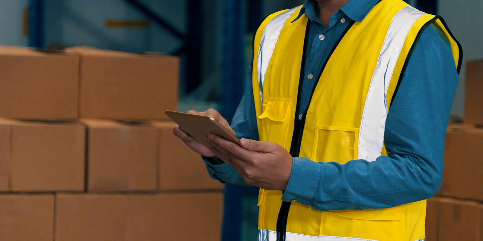 Asian warehouse worker checking packages in storehouse