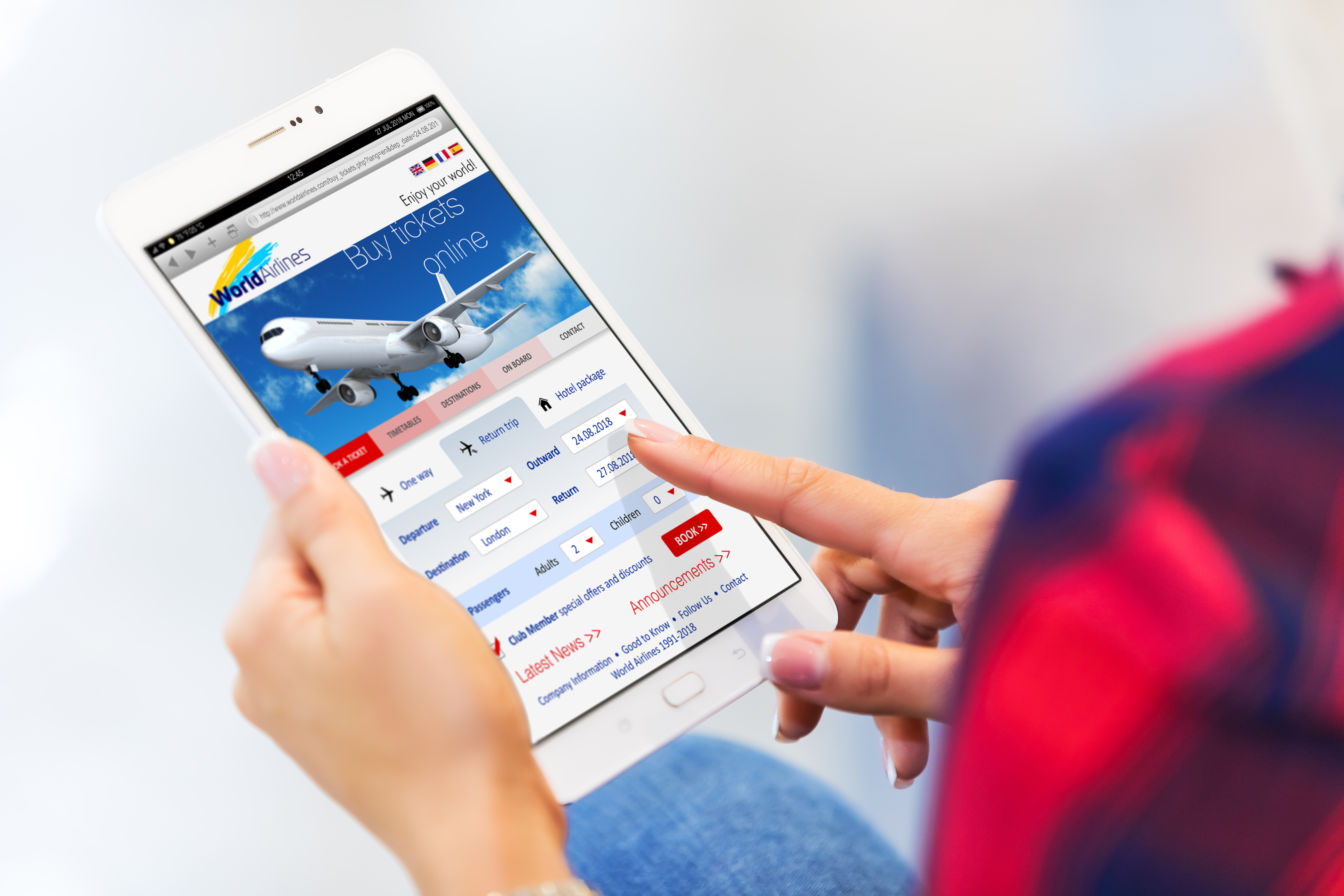 Young woman buying air tickets online on tablet computer