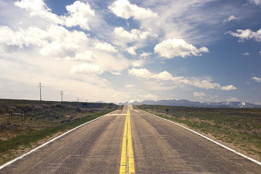 empty highway with clouds overhead via https://pixabay.com/photos/street-road-horizon-endless-238458/