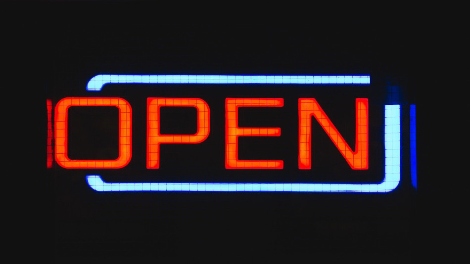 A neon sign that says open, from Pixabay https://pixabay.com/photos/sign-open-neon-business-electric-1209759/