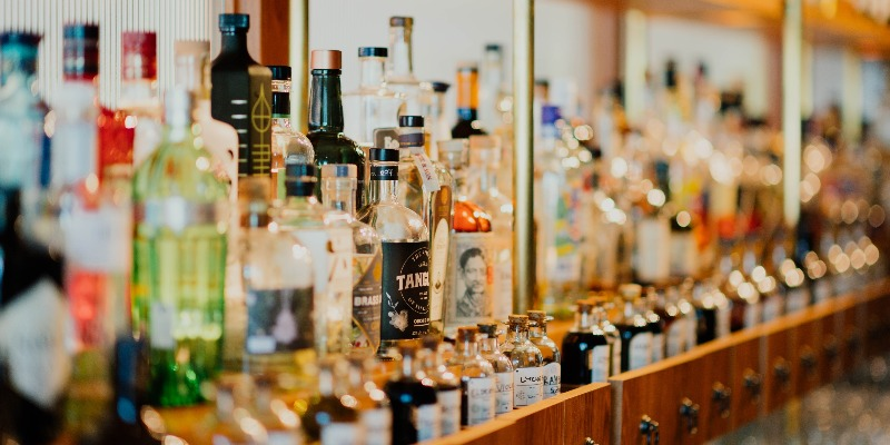 Bottles on a shelf lined up to show how bybe disrupts the adult beverage industry through its mobile app