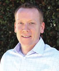 Headshot of Scott White CEO of FMG Suite