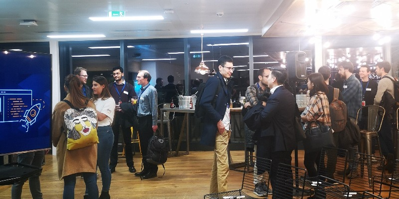 Startup Garage Event where entrepreneurs are mingling and having drinks