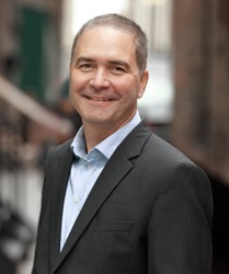 Gil Becker, President & CEO