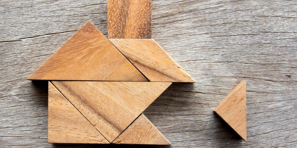 Wooden tangram puzzle of a house
