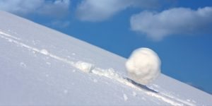 A snowball rolling downhill