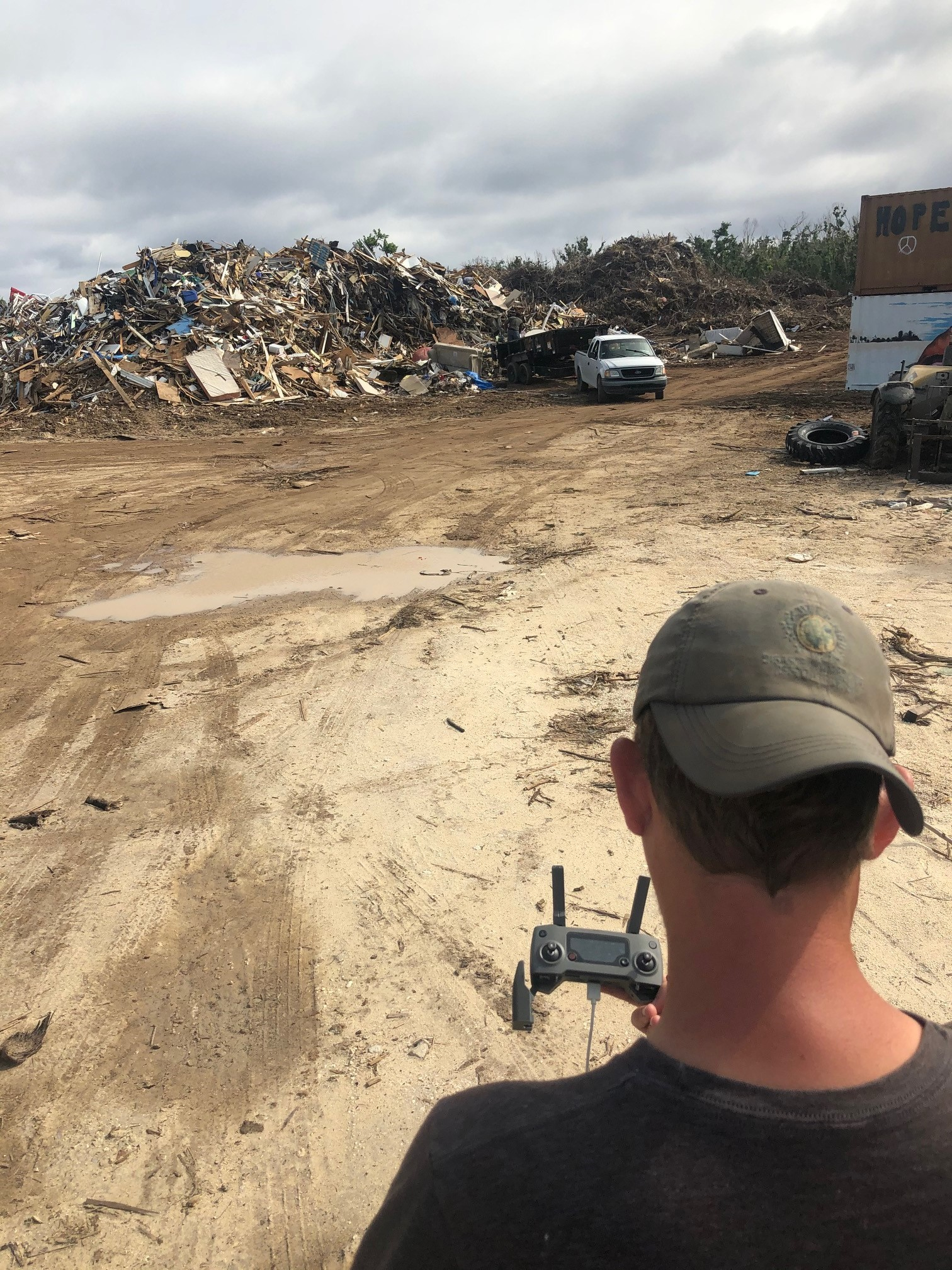 Help.NGO volunteers collect aerial imagery of damage on affected islands using drones.