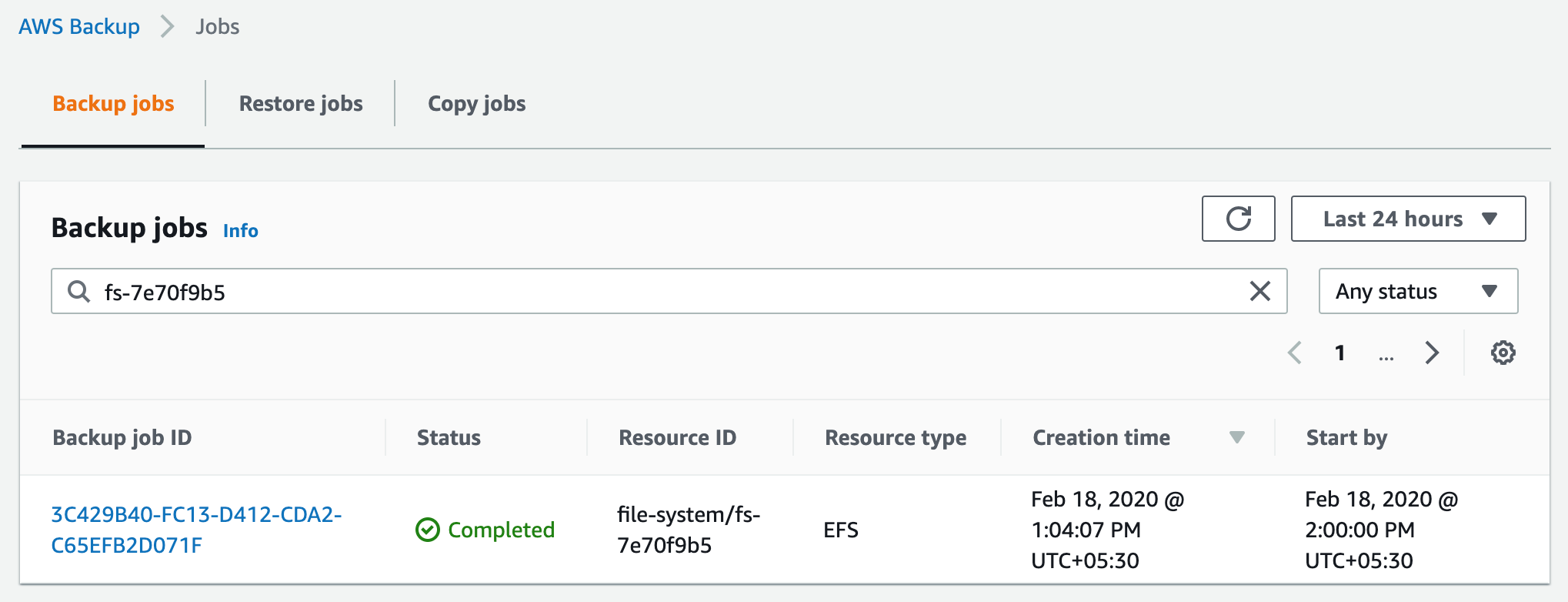 In this example scenario, the EFS file system (fs-7e70f9b5) has been backed up using AWS Backup as shown in the following screenshot
