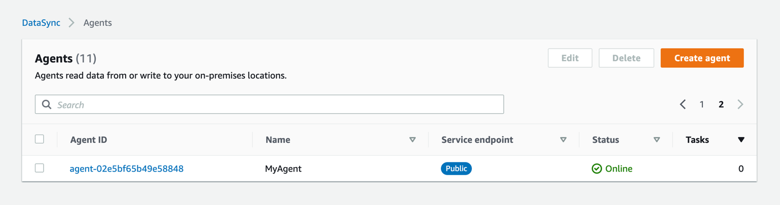 The AWS Management Console lists the newly activated agent along with its agent ID.