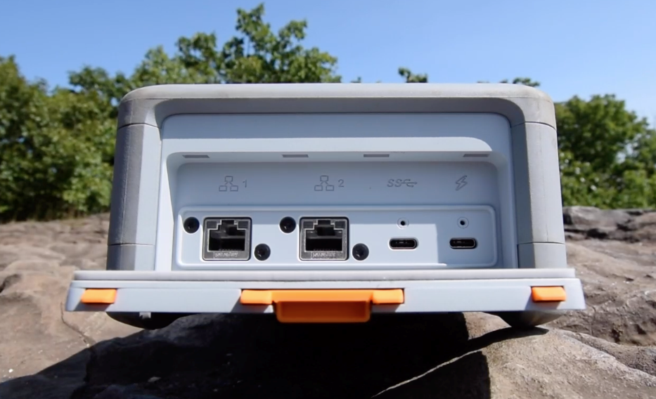 Open the rear panel of the Snowcone and connect the USB-C power source.