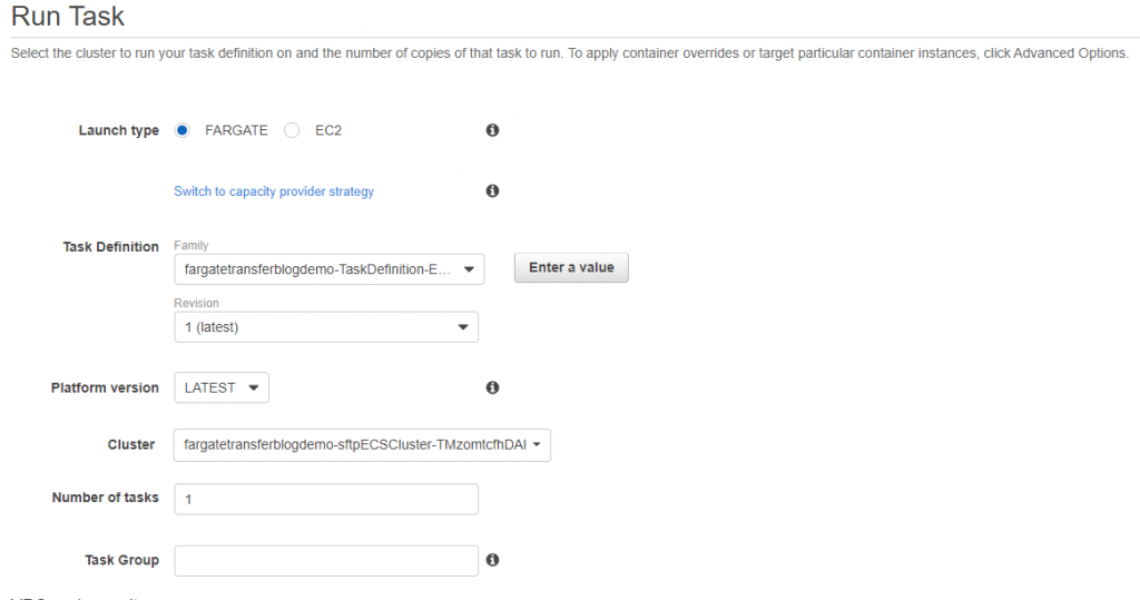 Select Fargate as the Launch type, and the Task Definition and Cluster created by CloudFormation.