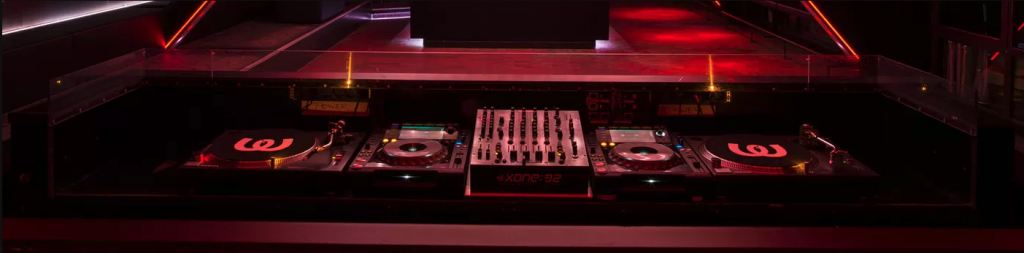 Mixing console in a dimly-lit nightclub