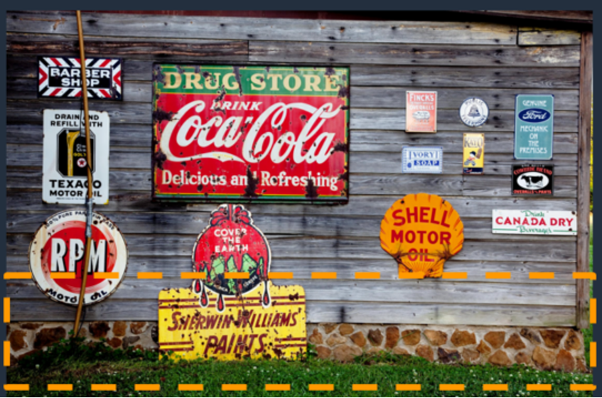 A wooden wall with metal signs on it