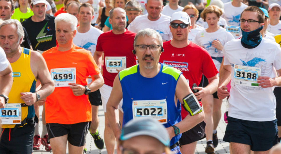 Runners in a race with jersey numbers