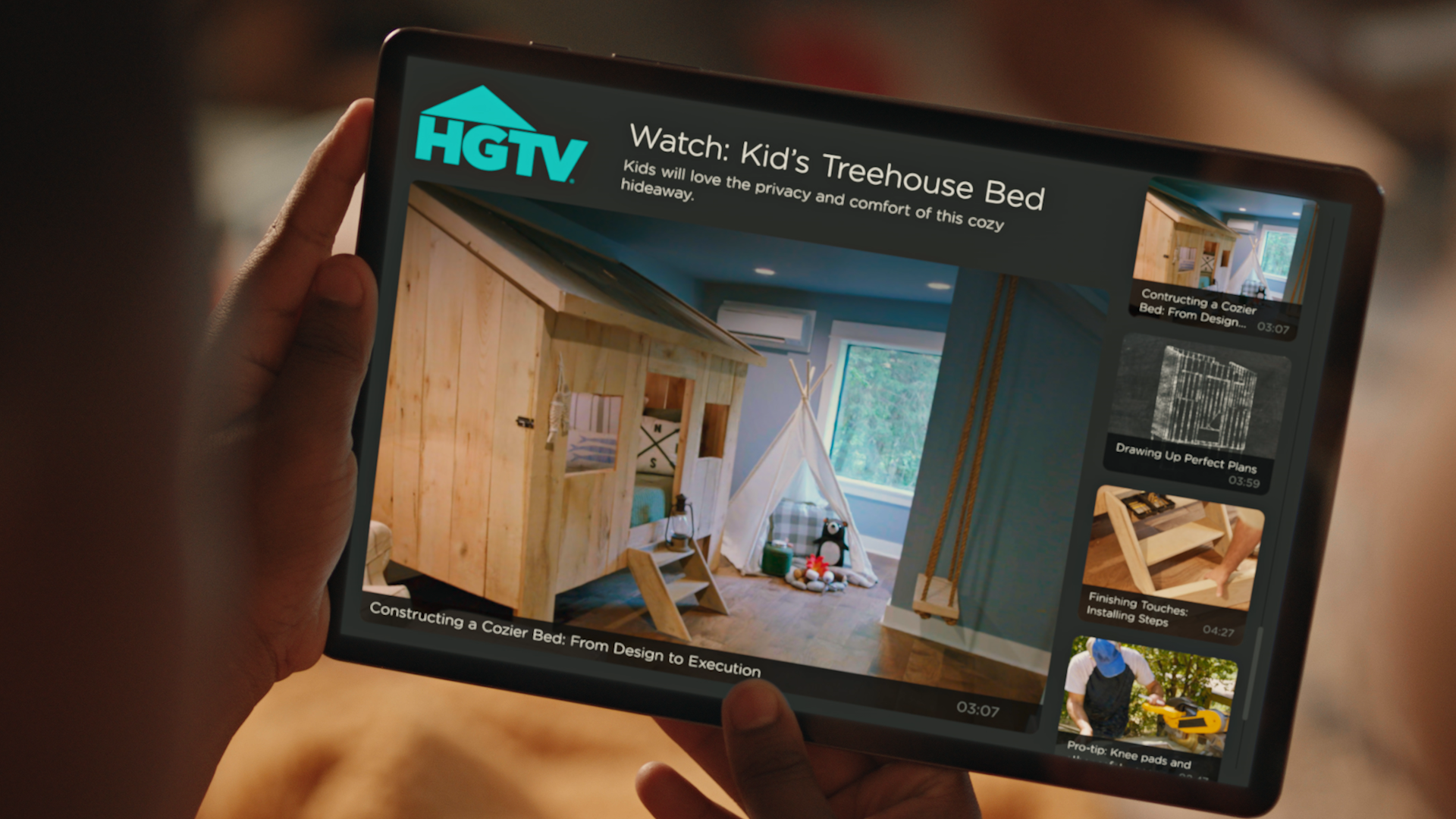 The Discovery+ app on a tablet. A subscriber enjoying HGTV favorites.