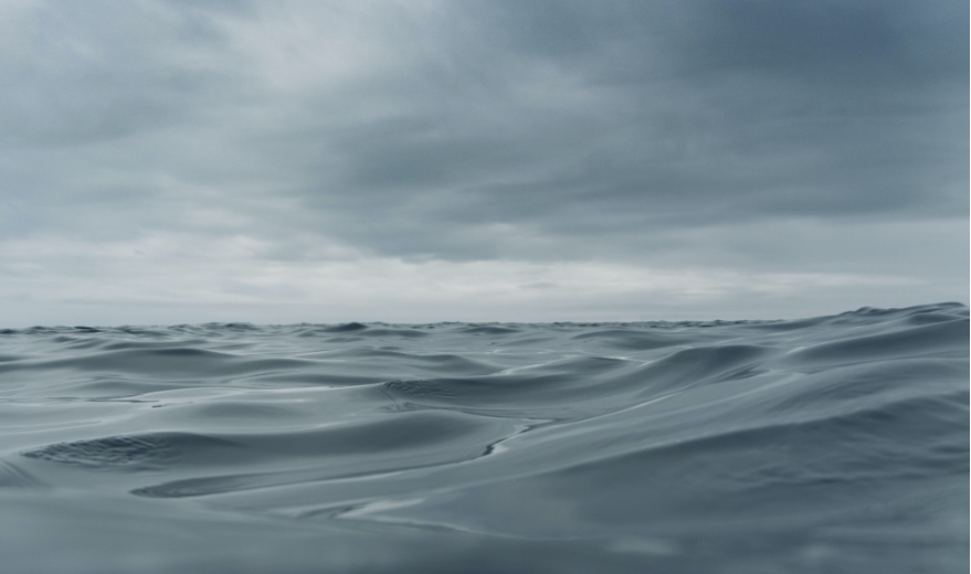 The sharper crests of waves in water help differentiate the feeling of an ocean from the surface of a cloud layer